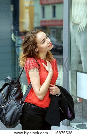 Stylish Girl Walking Down The Street