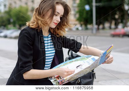 Girl Looks At A Tourist Map