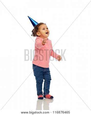 happy little baby girl with birthday party hat