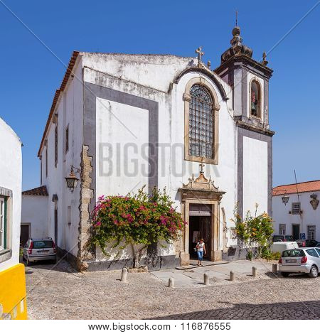 Obidos, Portugal - August, 2015: Sao Pedro church. Obidos is a medieval town inside walls, and very popular among tourists.