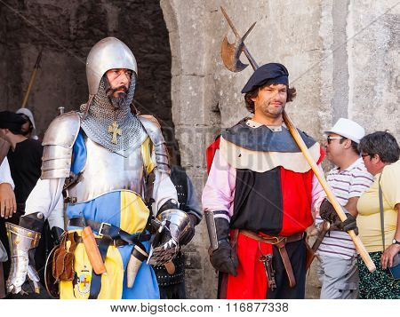 Obidos, Portugal - August 09, 2015: Medieval soldiers in the parade of the Medieval Market reenactment. The Medieval Market festival is very popular among tourists.