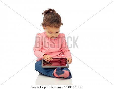 little baby girl playing with tablet pc computer
