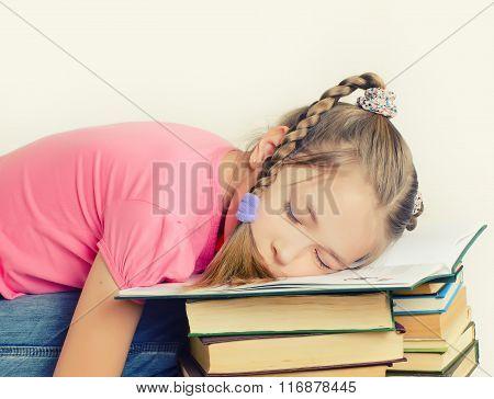 Girl Sleeping On The Book