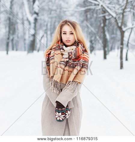 Beautiful Girl With A Winter Coat And Scarf Stands In The Park