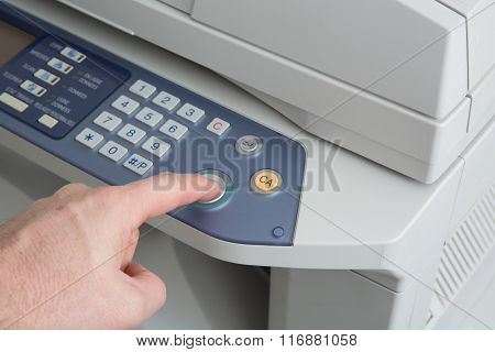 Midsection Of Business Man Operating Printer In Office