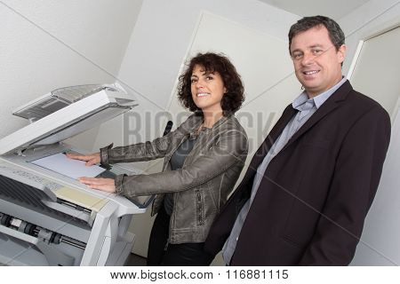 A Business Team Of Two People Planning Work In Office