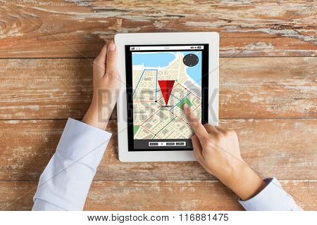 close up of hands with navigator map on tablet pc