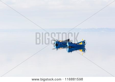 A Pair Of Blue Boats.