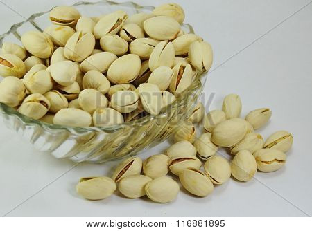 pistachio nut in glass bowl on white background