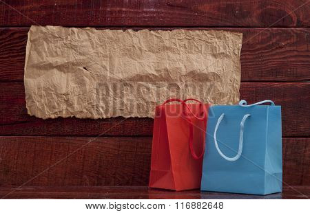 colorful  paper shopping bag on wooden table