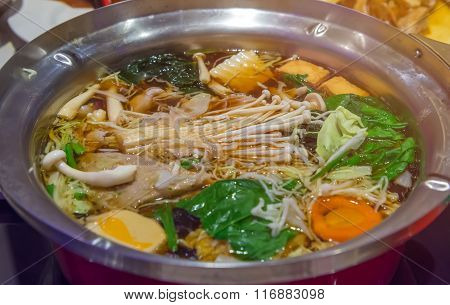 Seafood Sukiyaki Are Being Cooked In Pot