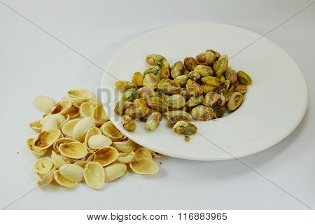 pistachio nut peel out on white dish