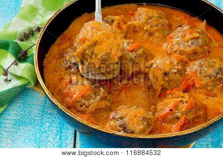 Homemade Meatballs In Tomato Sauce With Basil And Spices In A Frying Pan