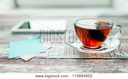 red tea with a tablet on a table in an office