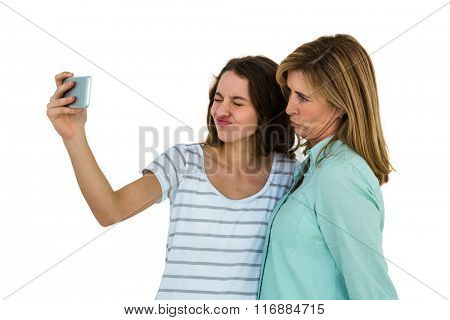 Mother and daughter make a selfie with a smartphone