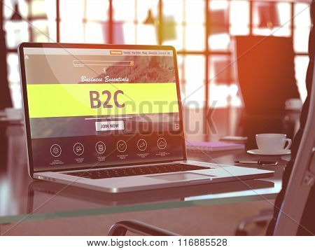 B2C on Laptop in Modern Workplace Background.