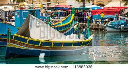 postcard with colorful fishing boat in the bay near Marsaxlokk in Malta