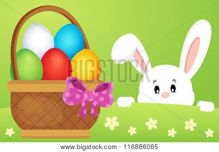 Lurking Easter bunny by basket with eggs - eps10 vector illustration.