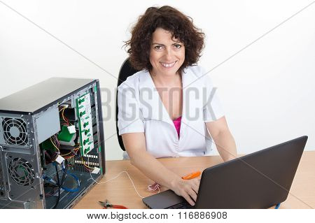 Brunette Hair Woman Wearing Uniform Sitting In Front Of Computer
