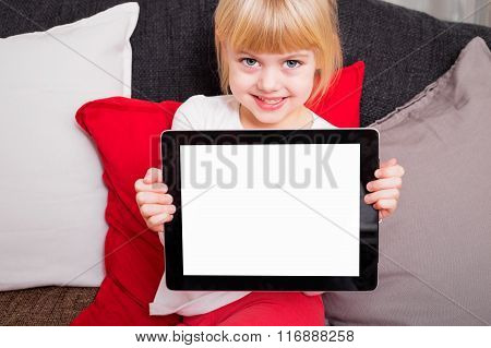 Little kid holding tablet and smiling