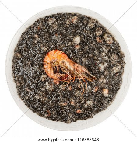 Black squid ink risotto with fried shrimp isolated on white