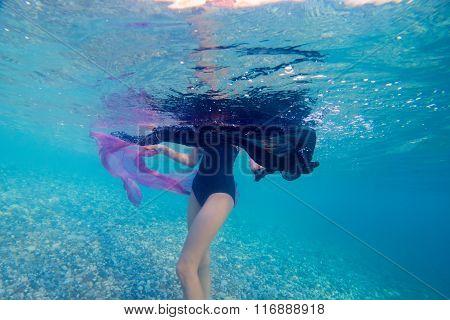attractive woman sunbathing at tropical resort