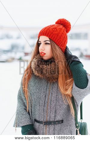Young Girl In A Stylish Warm Clothes Walking On A Winter Day On The Background Of The City