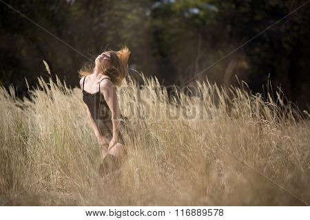 young girl with red hair in a field