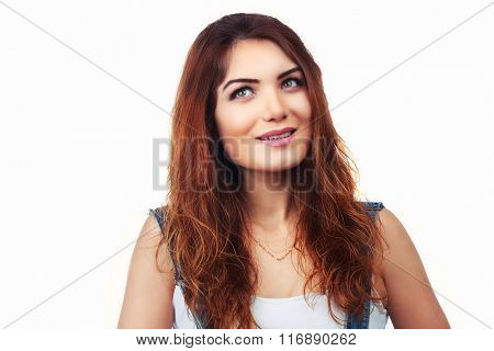 beautiful smiling woman looking up, isolated against white background
