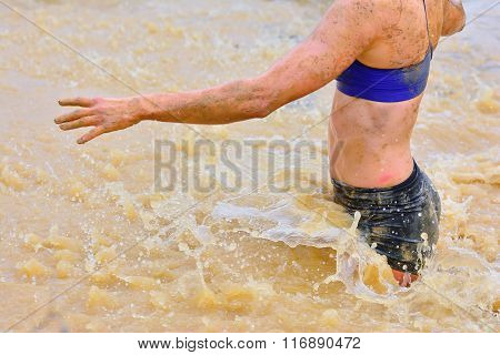 Woman Walking In Dirty Water