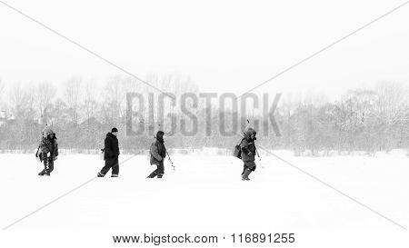 Russian Fishermen Ice Fishing In Winter