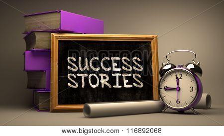 Success StoriesHandwritten by white Chalk on a Blackboard.