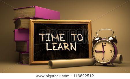Time to Learn Handwritten by white Chalk on a Blackboard.