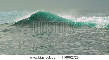 Powerful ocean wave breaking. Wave on the surface of the ocean. Wave breaks on a shallow bank. Natur