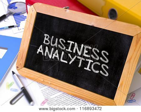 Business Analytics Handwritten by White Chalk on a Blackboard.