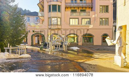 BAD RAGAZ SWITZERLAND - JANUARY 5 2015: People composition monument with sun flares in lens. Bad Ragaz is a city in the St. Gallen in Switzerland over the Graubunden Alps