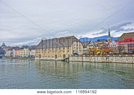 Waterfront and Clock Tower with Landhaus in Solothurn. Solothurn is the capital of Solothurn canton in Switzerland. It is located on the banks of Aare and on the foot of Weissenstein Jura mountains