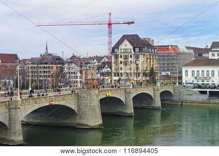 BASEL SWITZERLAND - JANUARY 1 2014: Waterfront of Central Rhine Bridge in Old City of Basel. Basel is a third most populous city in Switzerland. It is located on the river Rhine.