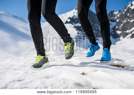 Legs of two runners