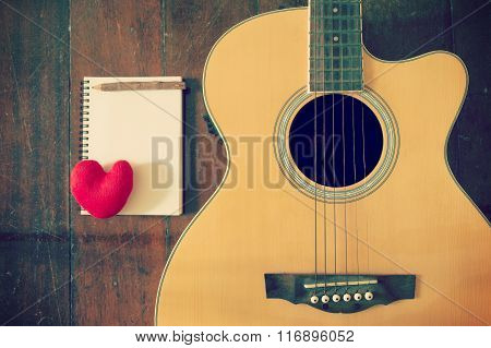 Notebook And Wooden Pencil With Heart On Guitar