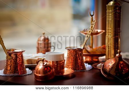 East coffee set : copper pots, old coffee mill, cup, sugar and eastern sweets