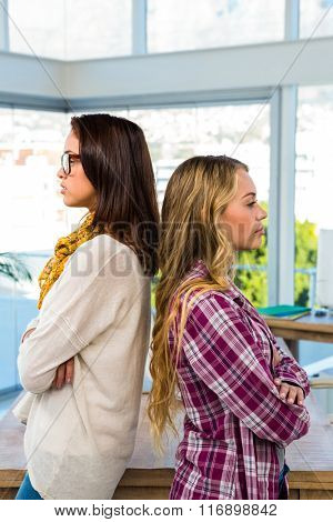 Two girls work at office and are concentrated