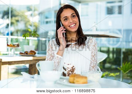 young girl calling by taking tea