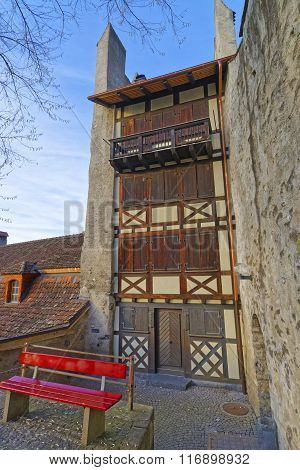 Thun, Switzerland - January 1, 2014: House with Timber Framing in the Old Town of Thun. Thun is a city in Swiss canton of Bern where Aare river flows out of Lake Thun. Town Hall Square is a historic center of the city