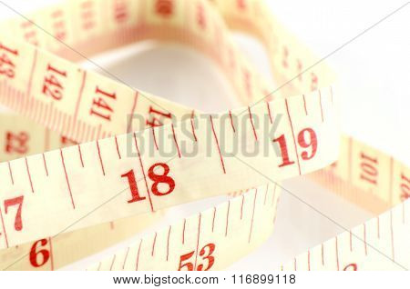 Tape Measure on White Background in Waistline and Weight Control Concept.