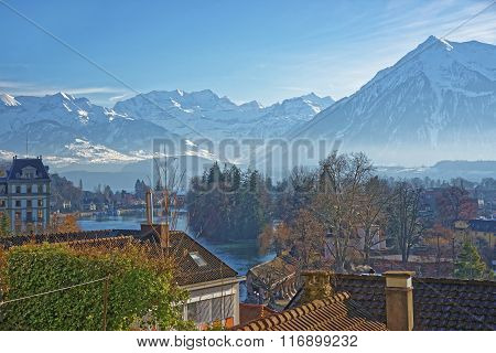 Panorama of the Town of Thun with Thunersee and the Alps. Thun is a city in the canton of Bern in Switzerland where the Aare river flows out of Lake Thun. There is a view of Bernese Alps.