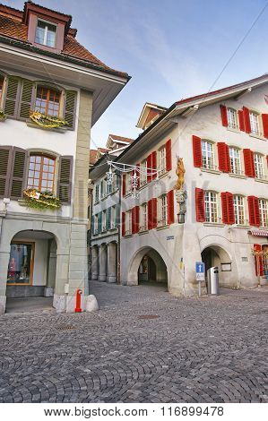 Town Hall Square in Old Town of Thun at Christmas. Thun is a city in the canton of Bern in Switzerland where the Aare river flows out of Lake Thun. The Town Hall Square is the historic center of Thun