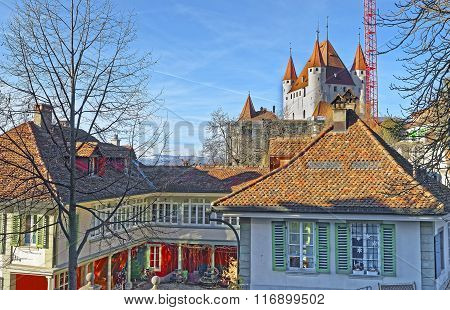 Thun Castle above houses in the Old City of Thun. Thun Castle is a Castle Museum in Thun in Swiss canton of Bern where the Aare river flows out of Lake Thun. Today it is a Switzerland heritage site.