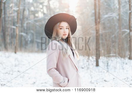 Beautiful Stylish Young Girl In A Fashionable Black Hat And Coat In The Winter Sunny Day.