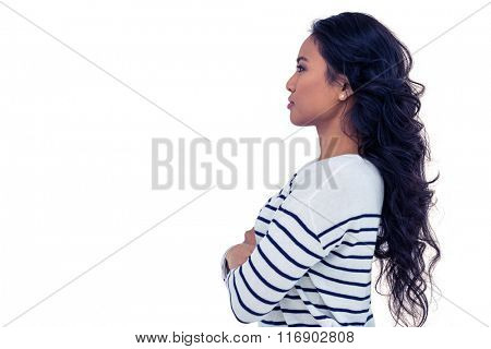 Side view of Asian woman with arms crossed on white screen